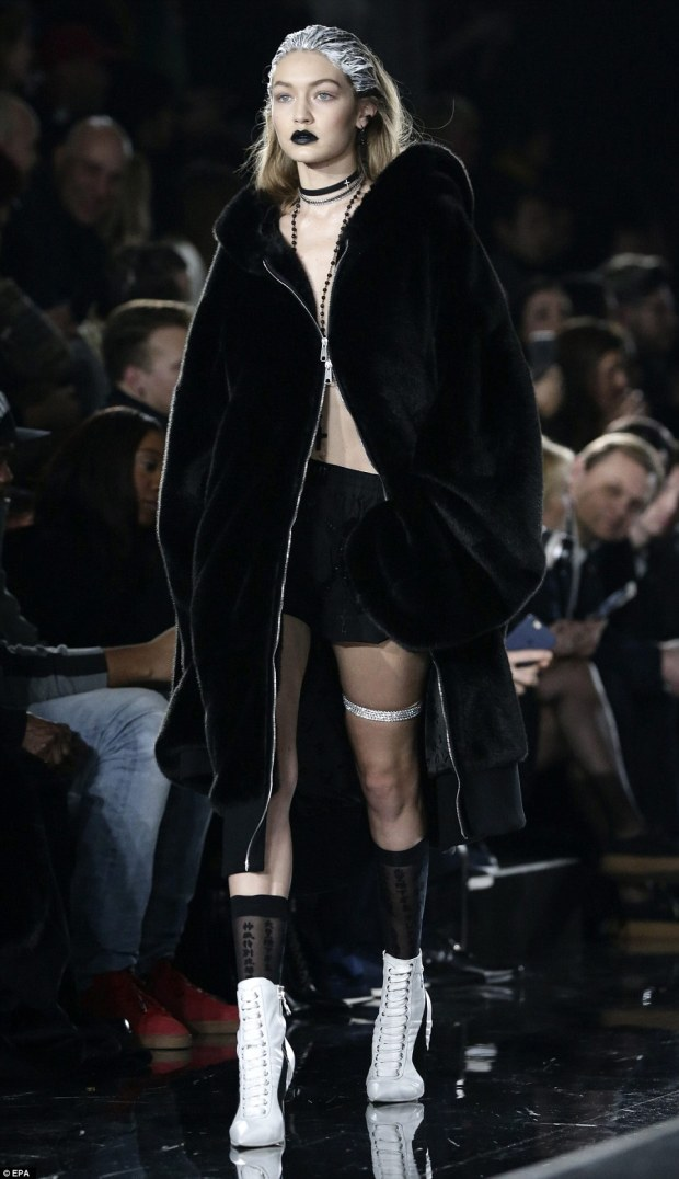 3126791A00000578-3445188-Fastened_tight_Hadid_went_shirtless_and_kept_the_coat_zippered_t-m-139_1455340221901